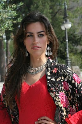 Pretty Woman Wearing An Embroidered Shawl